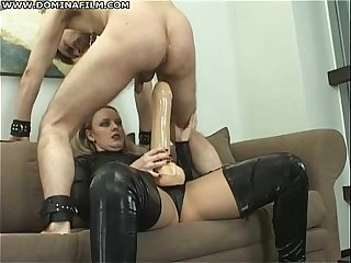 Big strapon in his ass - femdom