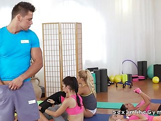 Fitness coach with assistant in threesome