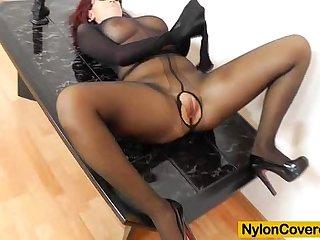 Nylon covered redhead masturbates plus toys