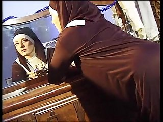 Dirty nun jerks off her pussy while she's spied on the keyhole