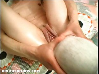 Gina jams a giant object in her wet pussy