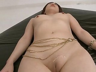Horny guys oil up Riko's shaved pussy and finger it